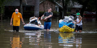 Houston, TX - SEPTEMBER 4: Residents who live near the Sam Houston Tollway in Houston, Texas, take boats, canoes and kayaks to retrieve their belongings, as much of their neighborhood remains flooded on Sept. 4, 2017, almost a week after Hurricane Harvey dumped 50 inches of rain on the city, overwhelming the reservoirs and flooding the city. (Photo by Cheryl Diaz Meyer for Le Monde)