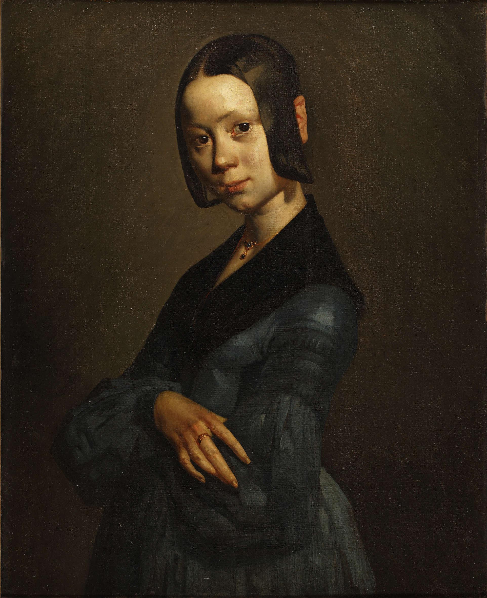 «Parce qu'il lui fallait gagner sa vie, Millet s'est d'abord adonné, avec bonheur, à l'art du portrait, qu'il expérimente avec les membres de sa famille. Ce portrait, austère, voire guindé, de sa jeune femme, Pauline, rappelle les portraits de famille que l'on trouve chez les notables de province. Mais bientôt le peintre s'offrira plus de liberté et s'autorisera à plus de volupté dans la représentation.»
