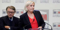 """Marine Le Pen, member of parliament and head of France's far-right National Front (FN) political party, attends a news conference on France's """"anti-terrorism"""" security bill at the National Assembly in Paris, France, October 3, 2017. At L, Member of parliament Gilbert Collard of France's far-right National Front (FN). REUTERS/Benoit Tessier"""
