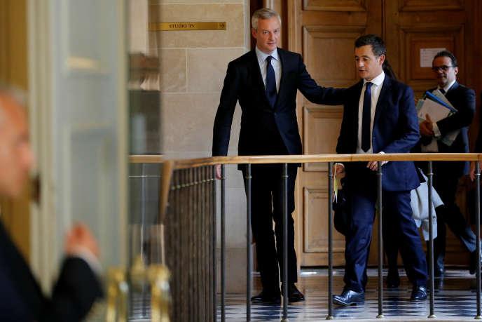 Bruno Le Maire et Gérald Darmanin à l'Assemblée nationale, à Paris, le 27 septembre.