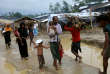 Rohingya refugees walk along the Balukhali refugee camp after the rain in Cox's Bazar, Bangladesh, October 6, 2017. REUTERS/Mohammad Ponir Hossain