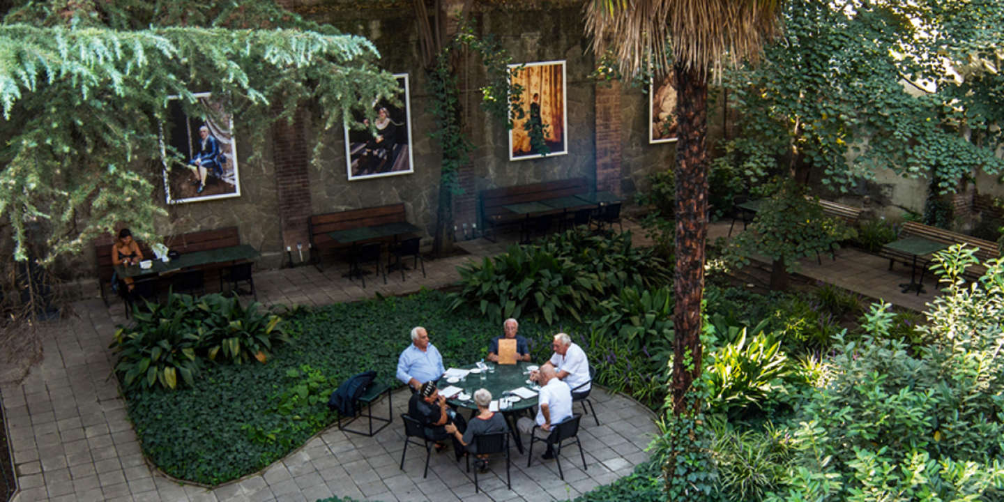 Tbilisi, Georgia, September 2017 : Littera - garden used by restaurant guests  located in the courtyard of  Writers House, XIX century building built by Georgian Aristocrat  and brandy manufacturer David Sarajishvili.