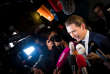 TOPSHOT - Austria's Foreign Minister and leader of Austria's centre-right People's Party (OeVP) Sebastian Kurz is surrounded by media as he arrives at Hofburg Palace for a TV debate following the general elections in Vienna, Austria, on October 15, 2017. Voting began in Austria in a snap election tipped to see conservative Sebastian Kurz, 31, become the EU's youngest leader and form an alliance with the far-right, in the bloc's latest populist test. / AFP / VLADIMIR SIMICEK