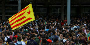 Students wave an Estelada (Catalan separatist flag) during a gathering to protest against the imprisonment of leaders of two of the largest Catalan separatist organizations, Catalan National Assembly's Jordi Sanchez and Omnium's Jordi Cuixart, who were jailed by Spain's High Court, in Barcelona, Spain, October 17, 2017. REUTERS/Ivan Alvarado