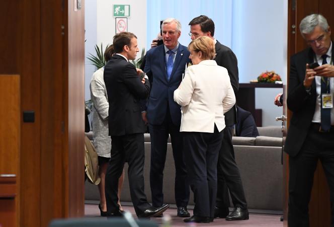 Emmanuel Macron, Michel Barnier, le premier ministre néerlandais Mark Rutte et Angela Merke, à Bruxelles le 20 octobre.