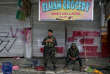 Soldiers take a break in front of a closed establishment after government troops cleared a war-torn area in Saduc proper in Marawi city, southern Philippines October 22, 2017. REUTERS/Romeo Ranoco     TPX IMAGES OF THE DAY