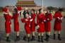 Des hôtesses du 19e congrès du Parti communiste, sur la place Tiananmen de Pékin, le 24 octobre.