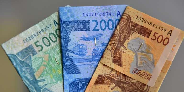 Les économistes sont divisés sur les coûts et les bénéfices du franc CFA, à la fois garant de stabilité mais monnaie trop forte pour des pays aux économies fragiles