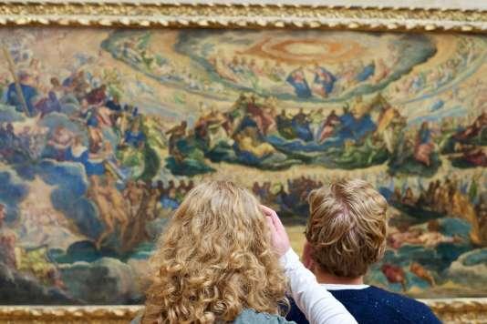 Deux enfants du « Paradis»du Tintoret, au Louvre, à Paris.