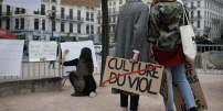 A woman holds a banner reading 'Rape culture' during a demonstration to support the wave of testimonies denouncing cases of sexual harassment, in Lyon, central France, Sunday, Oct. 29, 2017. French women are protesting sexual abuse and harassment in 11 cities across the country under the #MeToo banner in the wake of mounting allegations against Hollywood mogul Harvey Weinstein. (AP Photo/Laurent Cipriani)