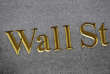 FILE - This Monday, July 6, 2015, file photo shows a sign for Wall Street carved into the side of a building in New York. Stock markets around the world took a pause on Monday, Oct. 30, 2017, from their record-setting run ahead of a busy week for markets. (AP Photo/Mark Lennihan, File)