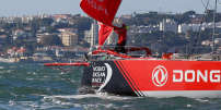 Crew members of Volvo Ocean Race team Dongfeng work on the boat during the departure for the second leg in Lisbon, Portugal November 5, 2017. REUTERS/Pedro Nunes
