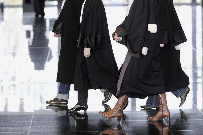 La nouvelle procédure oblige les parties à prendre chacun leur avocat, entraînant des frais supplémentaires. / AFP PHOTO / JEAN-SEBASTIEN EVRARD