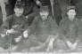 La photo retrouvée par la cousine du petit-fils de Claude Fournier, ce dernier est au centre. Une reconstitution faciale permettra l'identification.