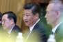 Le président chinois Xi Jinping (C) en discussion avec son homologue vietnamien, à Hanoï, au Vietnam, le 13 novembre 2017