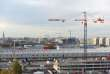 """A picture taken on November 16, 2017 shows cranes on construction sites in Bordeaux, southwestern France. Real estate explosion, traffic congestion, resentment against """"gentrification"""": the arrival of the high-speed train in Bordeaux highlighted the challenges the city has to deal with. / AFP / MEHDI FEDOUACH"""