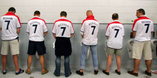 English fans from Belgium wearing David Beckham's number 7 jersey go to the toilet, 21 June 2004 prior to the European Nations football championships match against Croatia at the Estadio da Luz in Lisbon. Croatia and England are competing in Group B with Switzerland and France. AFP PHOTO ADRIAN DENNIS / AFP PHOTO / ADRIAN DENNIS