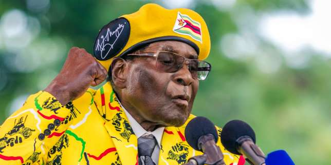 (FILES) This file photo taken on November 08, 2017 shows Zimbabwe's President Robert Mugabe addressing party members and supporters gathered at his party headquarters to show support to his wife becoming the party's next Vice President after the dismissal of Mnangagwa. President Robert Mugabe must leave office on November 19, 2017, the head of Zimbabwe's war veterans association said as pressure builds on the authoritarian leader to resign after a military takeover. / AFP / Jekesai NJIKIZANA