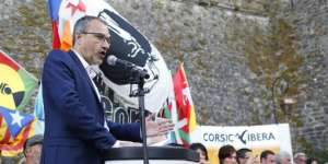(FILES) This file photo taken on August 06, 2017 shows the President of the Corsican Assembly and leader of the left-wing separatist party Corsica Libera, Jean Guy Talamoni delivering a speech during a meeting of the International days of Corte on the French Mediteeranean island of Corsica. The Corsicans, called upon to vote in the new territorial elections in December 2017, could help the nationalist candidates who present themselves united to obtain a status of autonomy to come to power, while the ghost of Catalan independence agitates the campaign. / AFP PHOTO / PASCAL POCHARD-CASABIANCA