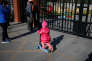 A child plays outside the kindergarten run by pre-school operator RYB Education Inc being investigated by China's police, in Beijing, China November 24, 2017. REUTERS/Jason Lee