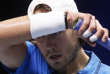 France's Lucas Pouille wipes his forehead as he plays Belgium's David Goffin during their Davis Cup final single match at the Pierre Mauroy stadium in Lille, northern France, Friday, Nov. 24, 2017. (AP Photo/Michel Spingler)