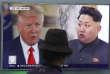 Un écran de télévision montrant Donald Trump etKim Jong Un, à Séoul, en août 2017.