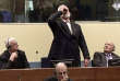 """TOPSHOT - This videograb taken from live footage of the International Criminal Court, shows Croatian former general Slobodan Praljak swallowing what is believed to be poison, during his judgement at the UN war crimes court to protest the upholding of a 20-year jail term. Former Bosnian Croat military leader Slobodan Praljak was alive and being treated by medics. - RESTRICTED TO EDITORIAL USE - MANDATORY CREDIT """"AFP PHOTO / ICTY"""" - NO MARKETING NO ADVERTISING CAMPAIGNS - DISTRIBUTED AS A SERVICE TO CLIENTS / AFP / International Criminal Tribunal for the former Yugoslavia / - / RESTRICTED TO EDITORIAL USE - MANDATORY CREDIT """"AFP PHOTO / ICTY"""" - NO MARKETING NO ADVERTISING CAMPAIGNS - DISTRIBUTED AS A SERVICE TO CLIENTS"""