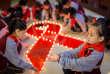 Des écolières lors d'un événement marquant la Journée mondiale du sida dans une école primaire à Hohhot, Région autonome de Mongolie intérieure, Chine 1er décembre.