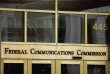 "FILE - This June 19, 2015, file photo, shows the entrance to the Federal Communications Commission (FCC) building in Washington. In its push to undo Obama-era ""net neutrality"" rules, the country's Republican-led telecom regulator has defended its proposal with some statements that are incomplete or misleading. But a Democratic official in favor of net neutrality also criticized the Federal Communications Commission Chairman, Ajit Pai, in a way that left out crucial context. (AP Photo/Andrew Harnik, File)"