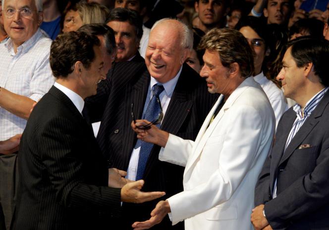 Nicolas Sarkozy et Johnny Hallyday lors du congrès de l'UMP, le 3 septembre 2006 à Marseille.
