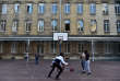 High school students play basket-ball at their boarding school at the Apprentis d'Auteuil-managed Saint-Philippe school in Meudon outside Paris on September 11, 2017. The youth charity Apprentis d'Auteuil helps young students in difficulties to reconcile them with school. / AFP PHOTO / CHRISTOPHE ARCHAMBAULT