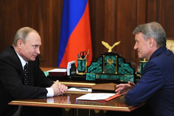 Le président Vladimir Poutine et Guerman Gref, le patron dela première banque publique russe Sberbank,le 4 août 2016.