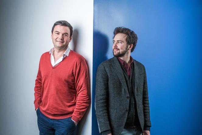 Thomas Piketty et Lucas Chancel, à Paris, le 7 décembre.