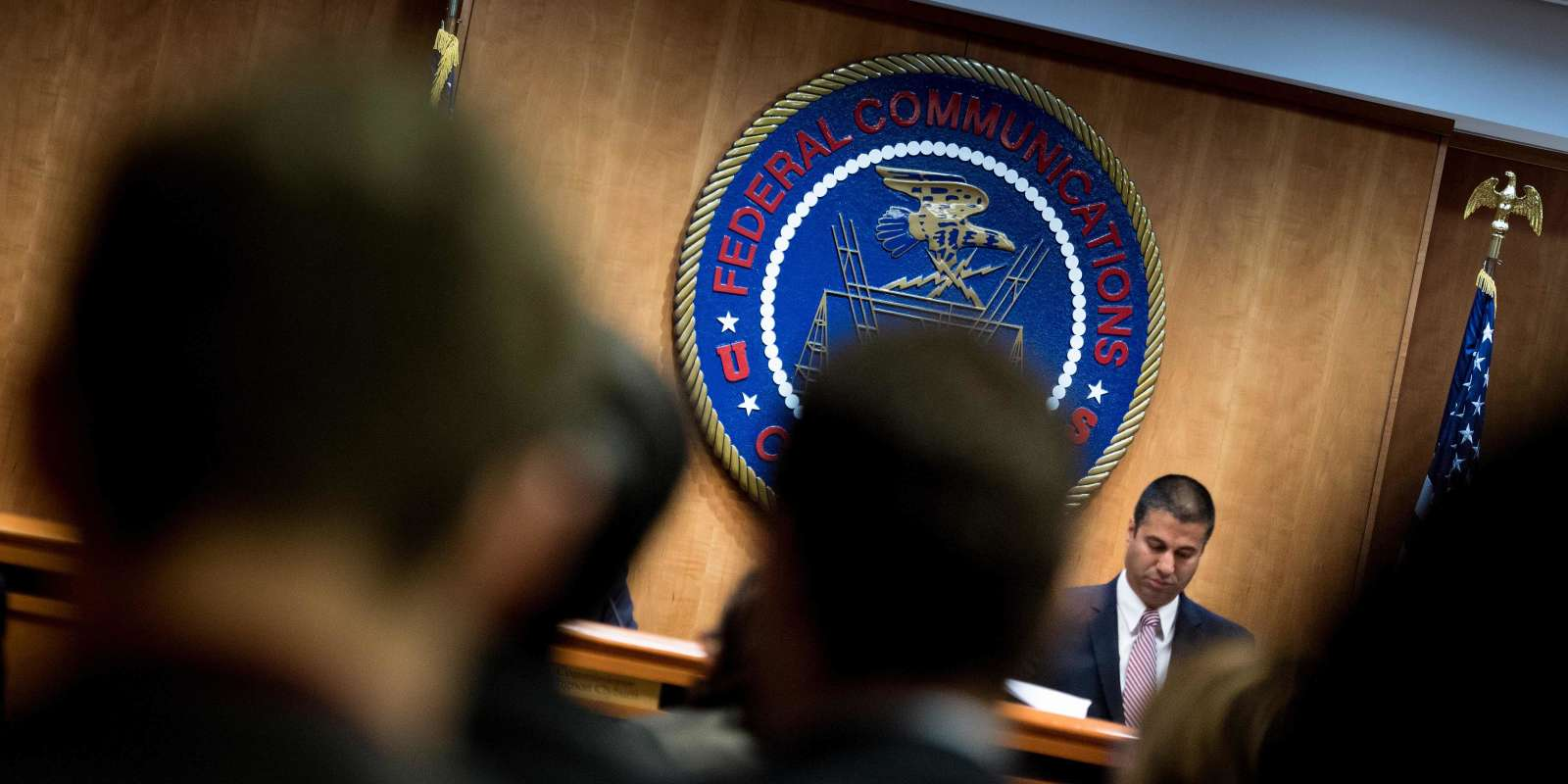 FCC Chairman Ajit Pai listens during a hearing at the Federal Communications Commission on December 14, 2017 in Washington, DC. / AFP / Brendan Smialowski