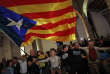 Catalan independence supporters wave a 'estelada' ( pro-independence Catalan flag ) celebrate at the ANC ( Catalan National Assembly ) headquarters after results of the regional elections in Barcelona, Spain, Thursday, Dec. 21, 2017. The pro-secession bloc won a majority but the anti-independence Ciutadans (Citizens), led by 36-year-old lawyer Ines Arrimadas, won the highest number of votes for a single party. ANC is Catalan pro independence platform promoting the political independence of Catalonia.(AP Photo/Emilio Morenatti)