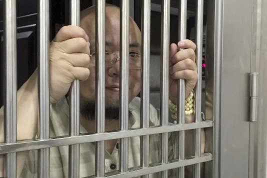 Cette photo datée du 19 mai 2015 montre le dissident Wu Gan détenu dans un commissariat de Nanchang, dans l'est de la province de Jiangxi, en Chine.