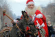 A man wearing a Santa Claus outfit walks with a donkey in Piatra Neamt, northern Romania, Thursday, Dec. 28, 2017. A parade of new year's traditions took place in the city.(AP Photo/Vadim Ghirda)