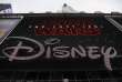 "(FILES) This file photo taken on December 14, 2017 shows the Disney logo displayed outside the Disney Store in Times Square in New York City. The latest episode in Disney's mammothly popular ""Star Wars"" series has passed the $1 billion mark in worldwide revenues in just three weeks, a Disney spokesperson said on December 31, 2017. ""Star Wars: The Last Jedi"" is expected to take in an estimated $65.6 million for the four-day holiday weekend in North America, for a total $530.3 million total since it opened there three weeks ago, said industry watcher Exhibitor Relations. / AFP / Drew Angerer"