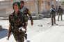 Des combattants kurdes à Rakka (Syrie), le 16 juin 2017.