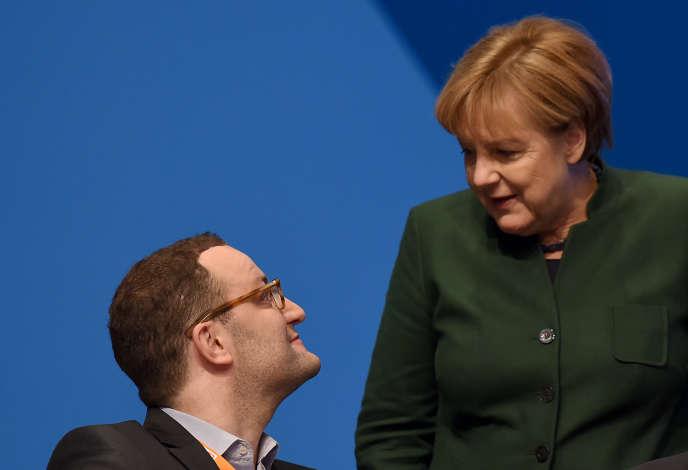 Le secrétaire d'Etat allemand aux finances,Jens Spahn, et la chancelière, Angela Merkel, en 2016 à Essen.