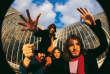 Pink Floyd en1969,à Kew Gardens.De gauche à droite : Nick Mason, Roger Waters, Richard Wright et David Gilmour.