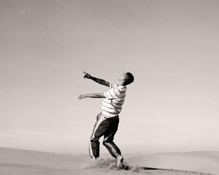 Polo en maille piquée, Sandro. Pantalon de jogging en nylon, Isabel Marant.Mannequins: Abderahmane Moutaâfif, Issam Elkalda, Ahmed Erraji, Mehdi Lahchouch, Abdelhamid Mana, Omar Bakkach. Casting : Walter Pearce @ Midland assisted by Said Zawi. Assistant photo : Piero Bressan Malvestio. Assistante styliste : Anna Tarissan. Coiffure : Jawara @ Bryant Artists. Production : Pandora Graessel@ graessel Studio. Production Executive : 1001 prod