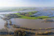 FILE - In this Jan. 8, 2018 file photo taken with a drone shows the flooded village of Rees at river Rhine, Monday, Jan. 8, 2018. Scientists say millions more people around the world are threatened by river floods in coming decades due to climate change. Researchers in Germany say greater flood defenses are particularly needed in the United States, parts of India and Africa, Indonesia and Central Europe. (Arnulf Stoffel/dpa via AP)