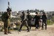 Des policiers israéliens procèdent à l'arrestation d'un Palestinien, après des affrontements qui ont émaillé une manifestation, à Nabi Saleh (Cisjordanie), de soutien à des prisonniers palestiniens.