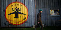 """A resident walks near his farm in """"La Vacherie"""" area in the zoned ZAD (Deferred Development Zone) in Notre-Dame-des-Landes, that is slated for the Grand Ouest Airport (AGO), France January 16, 2018. REUTERS/Stephane Mahe"""