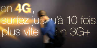 A person passes by, using a mobile phone, during a press conference, on June 21, 2012 in Marseille, southern France, announcing the France Telecom Orange fourth-generation (4G) mobile network technology, the next step forwards after 3G technology. Marseille is France's first city to be connected to Orange-France Telecom 4G mobile high-speed network, before the cities of Lyon and Nantes by the end of 2012, France Telecom Orange Chairman and CEO Stephane Richard announced today. AFP PHOTO FRANCK PENNANT / AFP PHOTO / FRANCK PENNANT