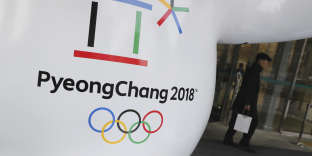 FILE - In this Thursday, Jan. 4, 2018, file photo, the official emblem of the 2018 Pyeongchang Olympic Winter Games is seen in downtown Seoul, South Korea. North Korea plans to send a spotlight-stealing delegation to next month's Winter Olympics in the South Korean county of Pyeongchang. (AP Photo/Lee Jin-man, File)