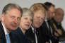 La première ministre britannique, entourée de son ministre des finances, Philip Hammond, et de celui des affaires étrangères, Boris Johnson, le 18 janvier 2018 à Sandhurst.