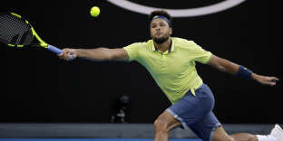 France's Jo-Wilfried Tsonga reaches for a forehand return to Australia's Nick Kyrgios during their third round match at the Australian Open tennis championships in Melbourne, Australia, Friday, Jan. 19, 2018. (AP Photo/Dita Alangkara)