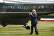 President Donald Trump reacts on seeing visitors to the White House as he walks on the South Lawn of the White House in Washington, Friday, Aug. 4, 2017, to board Marine One helicopter for a short trip to Andrews Air Force Base, Md. en route to Bedminster, N.J., for vacation. (AP Photo/Jacquelyn Martin, File)